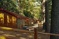 Log Cabins as presented by Meadowbrook Resort & Dells Packages in Wisconsin Dells
